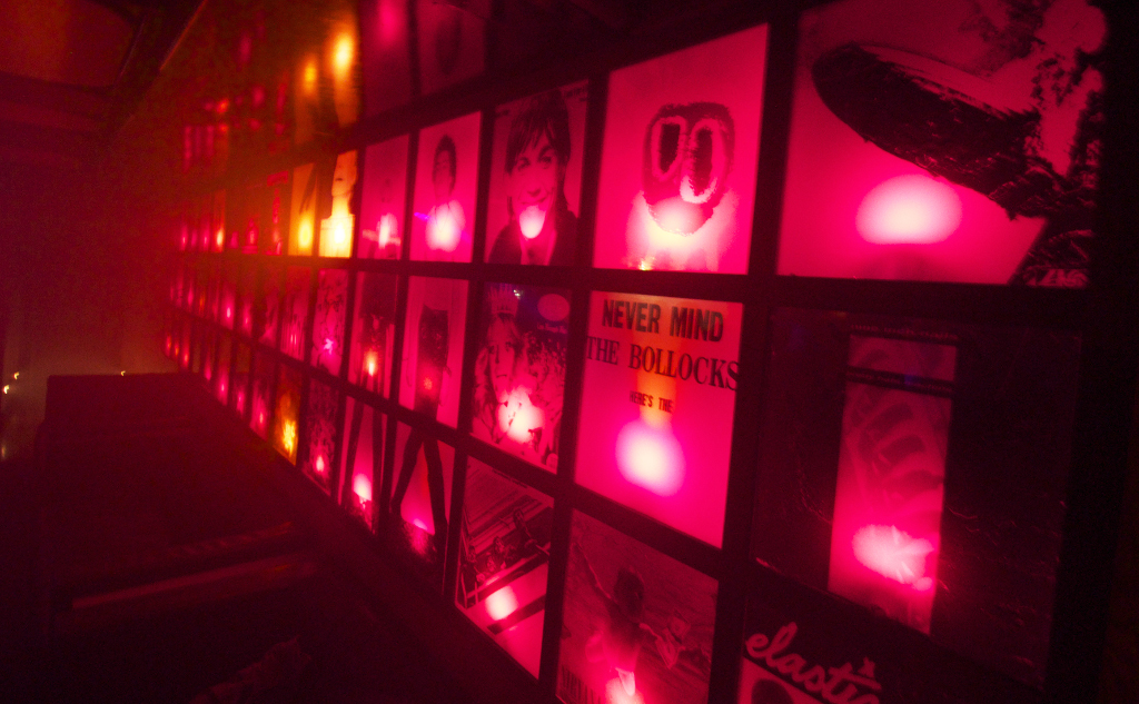 Wall of album art at The Star Bar